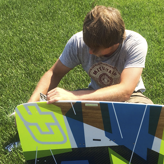 George I. Pare' of True Progression Kiteboarding assembling a 2014 Crazyfly Cruizer Pro board for a client.  Razor fins